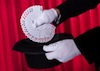 15388047-magician-hand-holding-fanned-deck-of-cards-from-hat.jpg